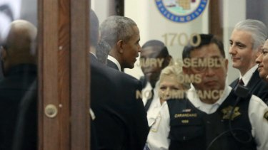 Former president Barack Obama arrives for jury duty in the Daley Centre in Chicago.