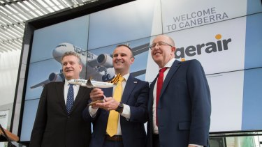Tigerair Australia chief executive Rob Sharp, left, Chief Minister Andrew Barr and Capital Airport Group managing director Stephen Byron announce the return of?Tigerair flights between Melbourne and Canberra.
