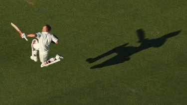 Oh, what a feeling: David Warner celebrates hitting the double-century mark in Perth.