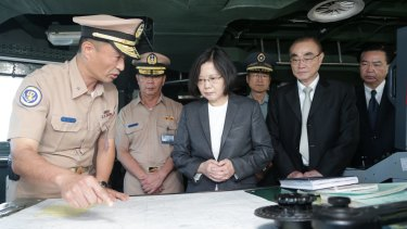 Taiwan's President Tsai Ing-wen (centre) reviews nautical charts aboard a Taiwan Navy ship. A new book claims Taiwan and China are the real Asian flashpoint, not North Korea.
