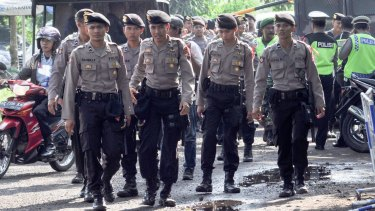 Soldiers and police arrive at Cilacap, the port of departure for Nusakambangan, where the executions will take place.