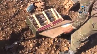 Captured: Video footage of an Islamic State group militant looking through the weapons cache appeared to be authentic.