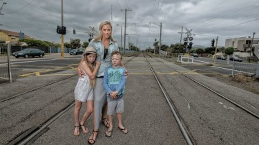 No sky rail on the Frankston line: Bonbeach resident Lori Weare and her children Sianna and Tahj are against the Andrews government's plan to build elevated rail near their home.