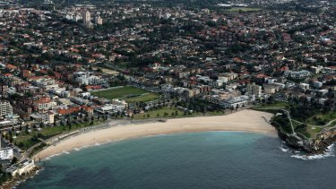 High demand: Coogee Beach and Sydney's CBD.