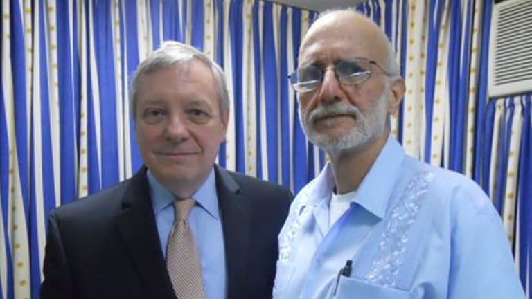 Free after five years ... US Senator Dick Durbin greets former Cuban prisoner Alan Gross after he arrived at Andrews Air Force Base in Maryland.