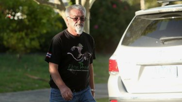 A man arrives at the Ristevkis' Avondale Heights home on Tuesday.