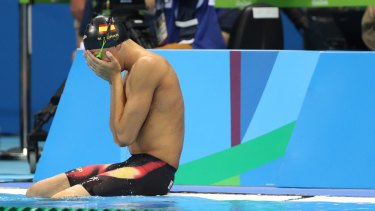 Spain's Miguel Duran Navia cries after tumbling into the pool before his heat.