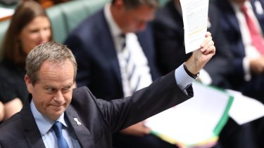 Opposition Leader Bill Shorten has attacked the Abbott government's cuts to the ABC budget but won't say by how much he would restore the funding if elected Prime Minister.