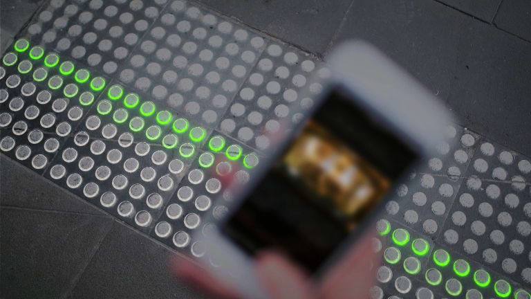 A smartphone user gets the green light from Buro North's Smart Tactile Paving.