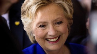 Democratic presidential candidate Hillary Clinton greets members of the audience after speaking at a rally.