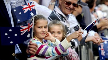 People watch the Anzac Day march in Sydney.