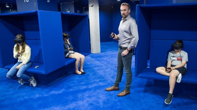 Artist Tom Crago with his virtual reality exhibit.