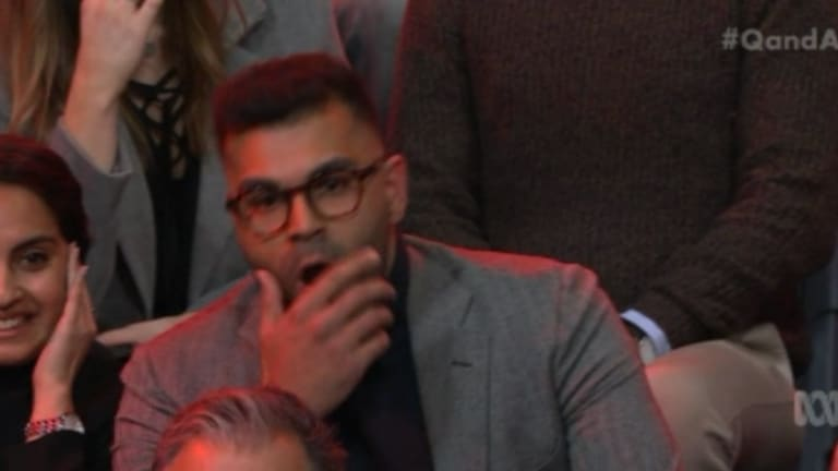 Tarang Chawla puts his hand over his mouth as Steve Price speaks to Van Badham on Q&A.