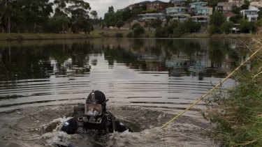 Police divers scour the Maribyrnong River for the body parts of Brendan Bernard in February 2015.