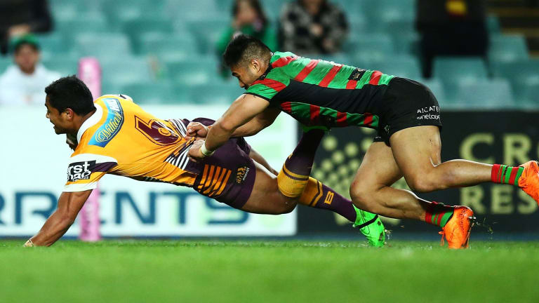'Soft': Anthony Milford dives over for another try to the Broncos.