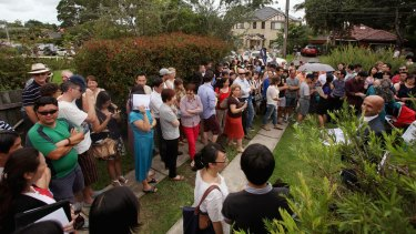 A crowd of mainly Chinese buyers at a hot auction in Sydney.