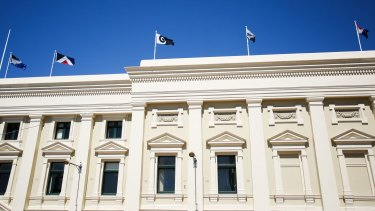 The final five flag designs fly on top of the Wellington Town Hall on October 12.