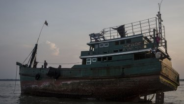 A boat that carried Rohingya and Bangladeshi migrants, now abandoned in Kuta Binie, Indonesia.