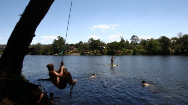 Penrith residents seeking refuge in the Nepean River during scorching weather of 47.3 degrees on Sunday.