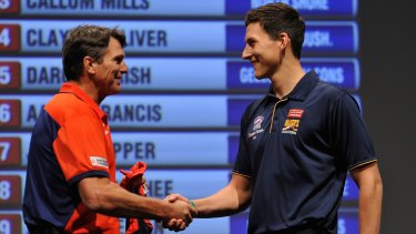 Weideman being welcomed to the club at last year's Draft by Paul Roos.
