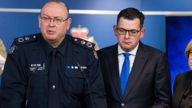 Chief Commissioner Graham Ashton with Premier Daniel Andrews after June's Brighton shooting. Ashton is due back on duty in mid-January.
