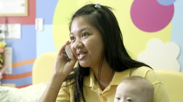 Pattaramon Chanbua, 21, with her son Gammy in 2014. The Baby Gammy scandal led to Thailand closing surrogacy clinics across the nation and driving clients to Cambodia.