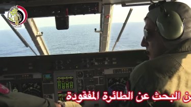 An Egyptian plane searches in the Mediterranean Sea for crashed EgyptAir flight 804.