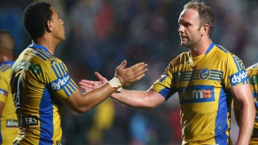 Big upset: Will Hopoate and David Gower of the Eels celebrate victory at Brookvale.
