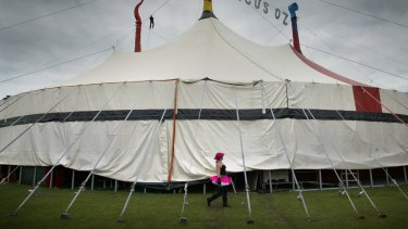 Performer Mel Fyfe walks around the Circus Oz tent.