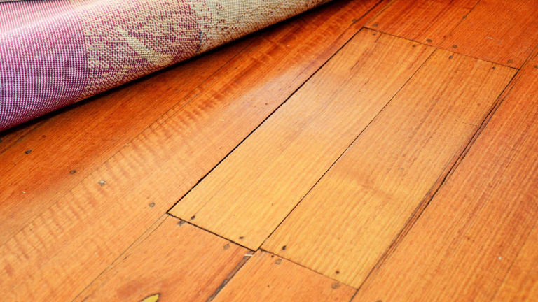 What caused these two floorboards to break during a dinner party at Manning Clark House?