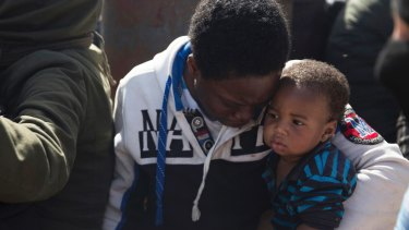 Migrants wait for medical attention at Abosetta base in Tripoli, Libya.