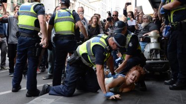 Police arrest one of the rough sleepers.