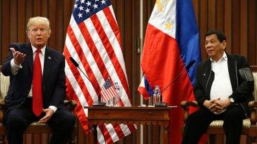 US President Donald Trump, left, gestures beside Philippine President Rodrigo Duterte during their meeting in Manila.