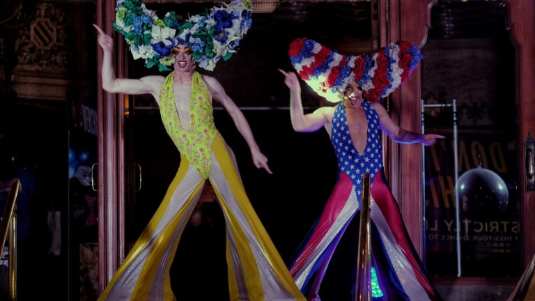 Cast members from Priscilla Queen of the Desert perform on the steps of the Regent Theatre as part of White NIght.