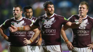 All over: Blake Leary, Josh Starling and Jake Trbojevic of the Sea Eagles look dejected at Brookvale.