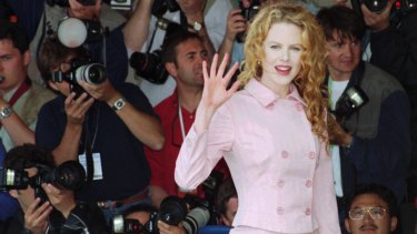 "Nicole Kidman, waves to photographers before her press conference for the film "" To Die For""."