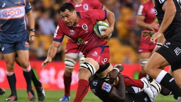 Queensland Reds player George Smith has been arrested in Japan for allegedly punching a taxi driver.