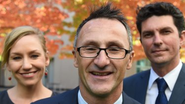 Greens leader Richard Di Natale (centre) has lost two of his senators to dual-citizenship confusion, Larissa Waters and Scott Ludlam.