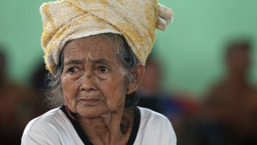 An elderly woman sits at a temporary shelter following the eruption of Mount Agung in Klungkung, Bali on Saturday.