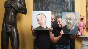 In the living room: Michael Eyes and Gordon Elliott with a 250-kilo  Terry Stringer statue and <i>Thor</i> by Euan MacLeod. Eyes holds Juan Ford's <i>Portrait Of Michael</i>, Elliott holds MacLeod's <i>Gordon I</i> and Todd Fuller's <i>Pinkie</i> sits on the mantel.