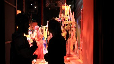Actors and technical staff wait in the wings of the Sydney show of Aladdin.