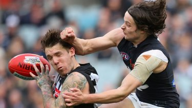 Just a glancing blow: Dane Swan had more than 40 possessions.