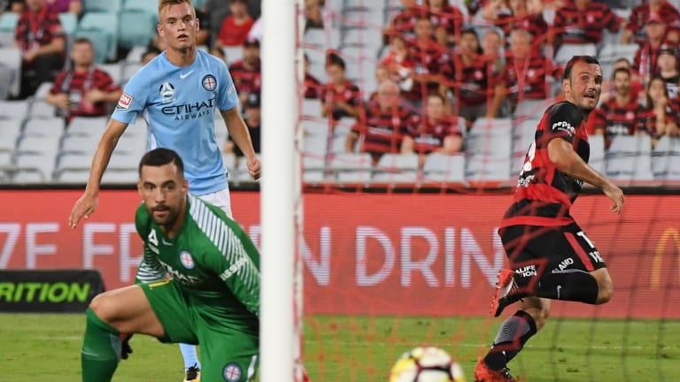 Game-breaker: Mark Bridge rolls the ball into the back of the net as City keeper Dean Bouzanis can only watch helplessly.