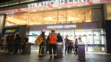 Emergency services personnel at Stratford Centre after the suspected acid attack.