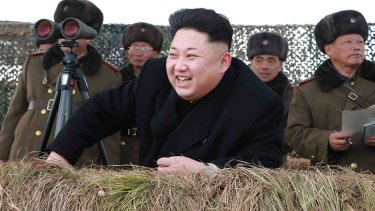 North Korean leader Kim Jong Un laughs as he watches a winter river-crossing attack drill of the armoured infantry sub-units earlier this year.