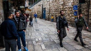 Israeli police officers patrol Jerusalem's occupied Old City.