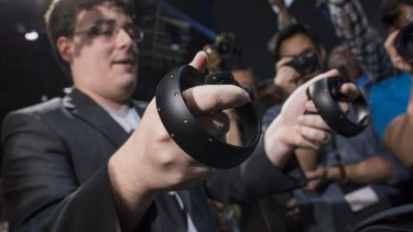 """The new Oculus Touch controller is demonstrated during the """"Step Into The Rift"""" event ."""