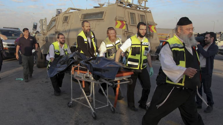 Israeli emergency services respond to an attack near the West Bank Gush Etzion settlements.