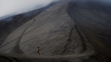 Dain walks up a volcano in <i>Tanna</i>.