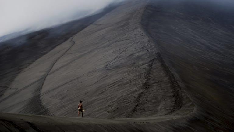 Dain walks up a volcano in <i>Tanna</i>.